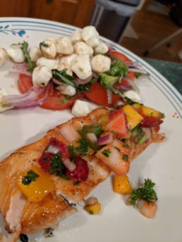 finished salmon with salad